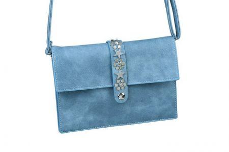 blauw schoudertasje met sterren en studs